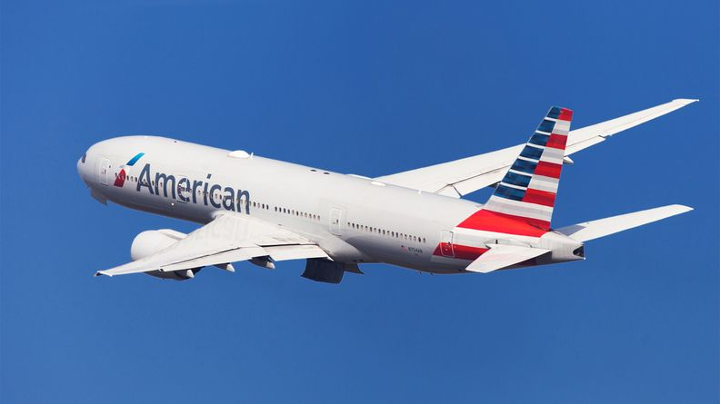 American Airlines Boeing 777-200ER banking left after taking off from El Prat Airport in Barcelona
