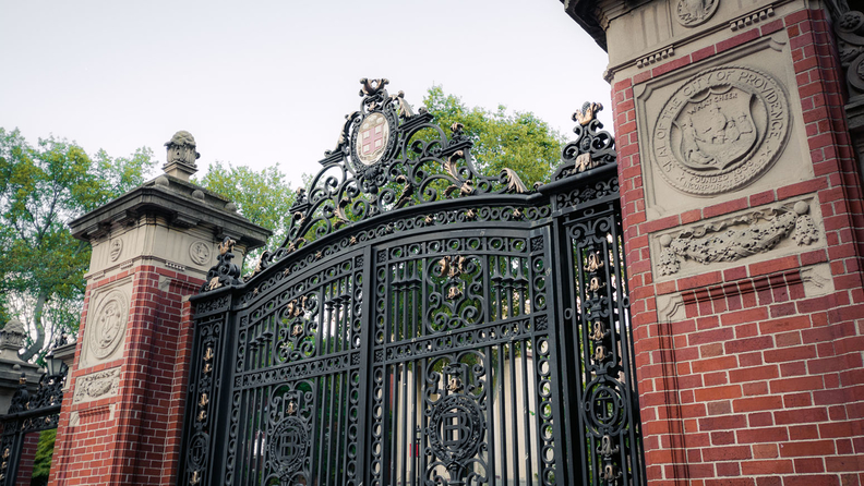 A closed gate is seen outside the entrance to the Front Green on the campus of Brown University.