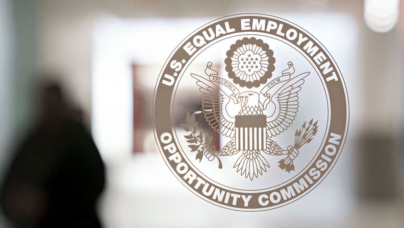 The Equal Employment Opportunity Commission (EEOC) seal is displayed on a window at the headquarters in Washington