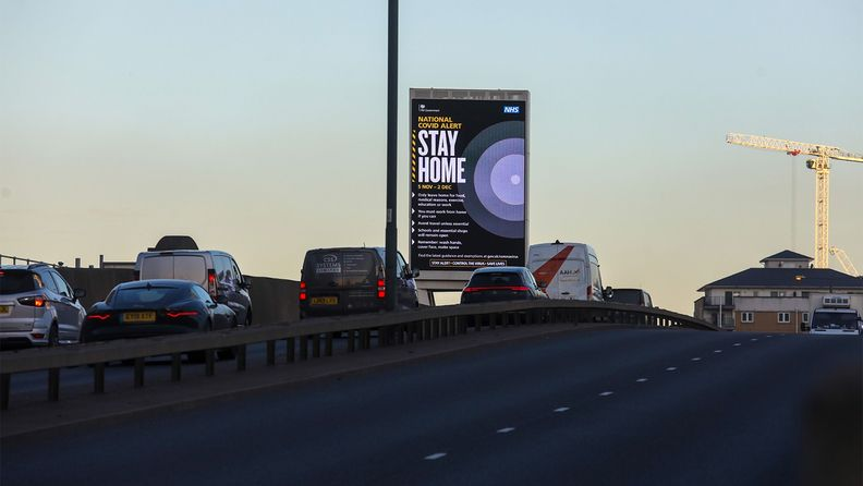 A large 'Stay Home' advertisementon a highway in London amid a resurgence in the number of COVID-19 cases