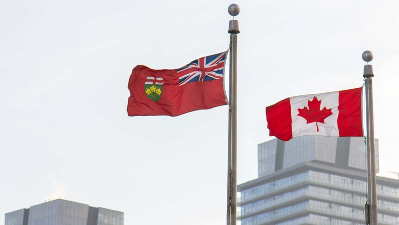 The flags of the province of Ontario and Canada