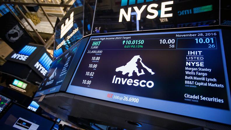 Invesco logo shown on the floor of the New York Stock Exchange