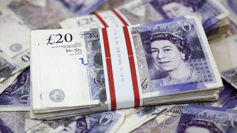 a stack of £20 U.K. notes