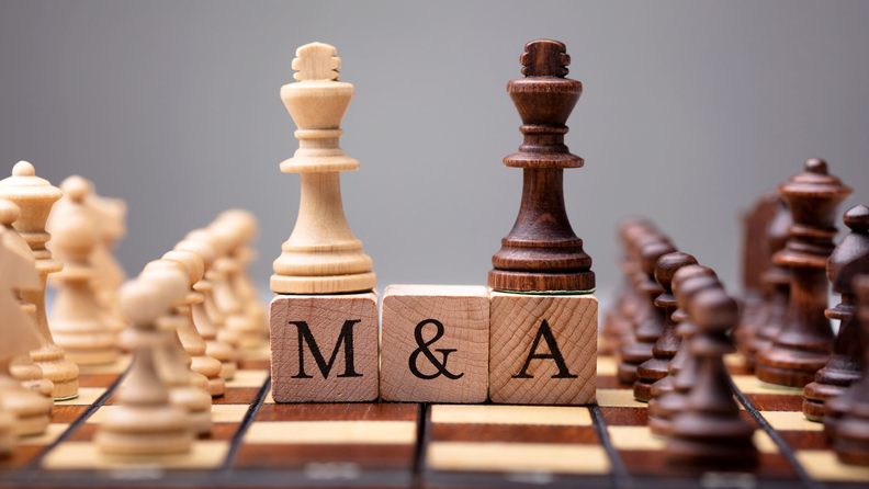"mergers and acquisitions ""M&A"" wood blocks on a chess board"