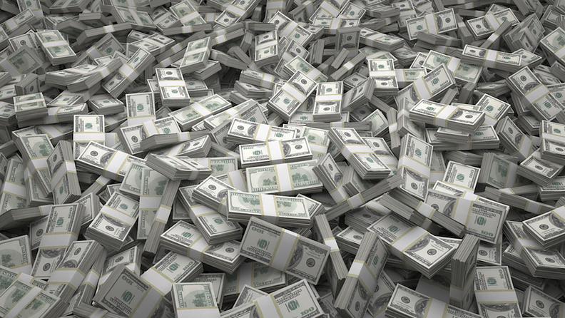 a pile of stacks of U.S. currency