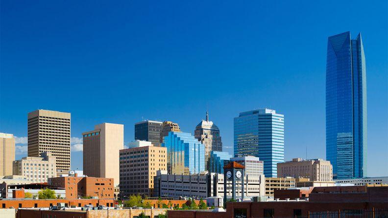 The Oklahoma Cityskyline with a deep blue sky, featuring the new Devon Energy Center building