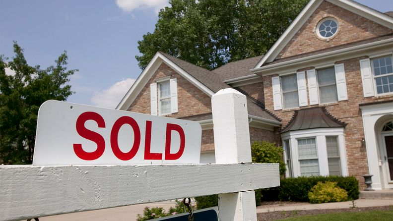 Sold house sign in Midwest suburban setting