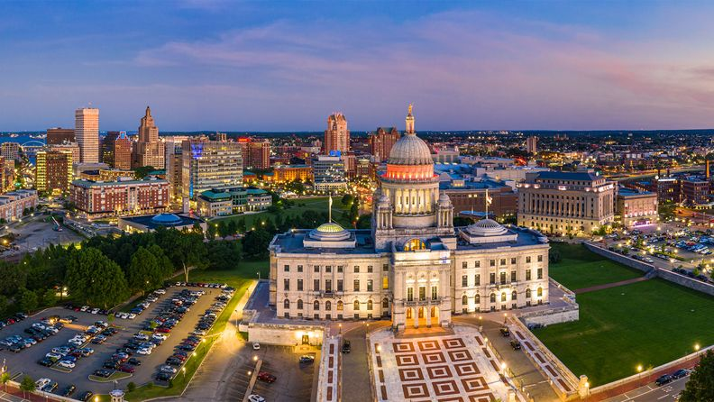 Aerial panorama of Providence skyline and Rhode Island Capitol at dusk