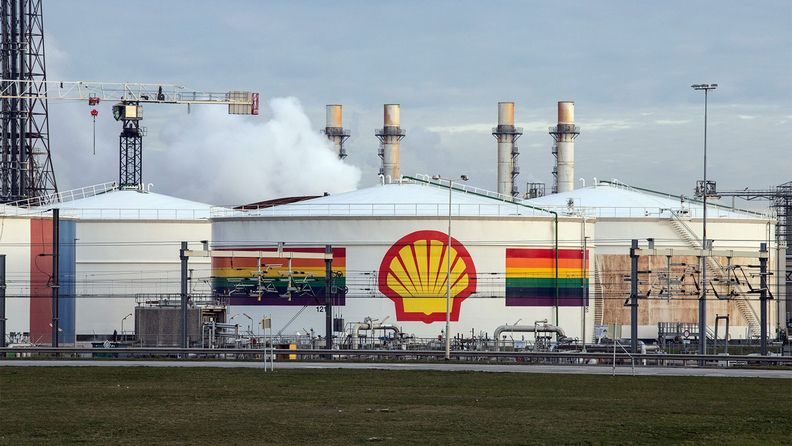 A Royal Dutch Shell PLC logo on an oil silo at the Shell Pernis refinery in Rotterdam, Netherlands