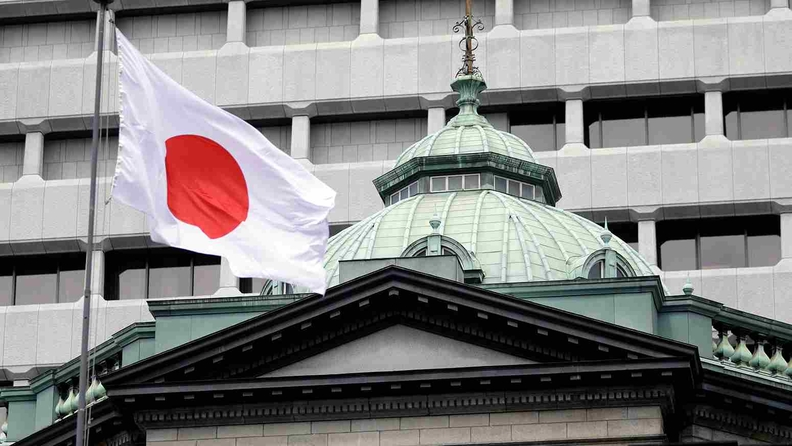 The Japanese flag flies over the Bank of Japan headquarters in Tokyo