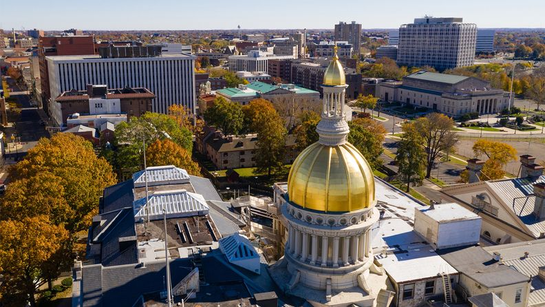 The New Jersey State House dome reflects sunlight late afternoon in downtown Trenton, N.J.