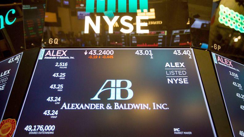 A monitor displays Alexander & Baldwin Inc. signage on the floor of the New York Stock Exchange on Nov. 13, 2017