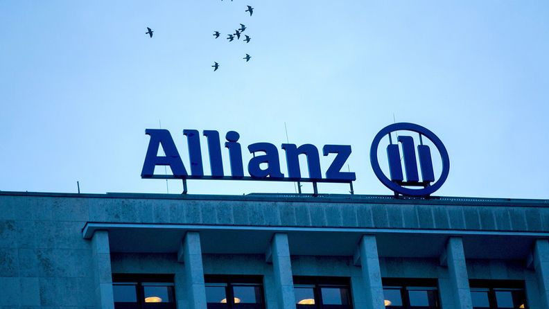 Allianz logo atop a building with view of sky and birds