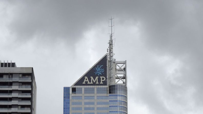 The AMP Ltd. logo atop the company's Bourke Place building in the central business district of Melbourne
