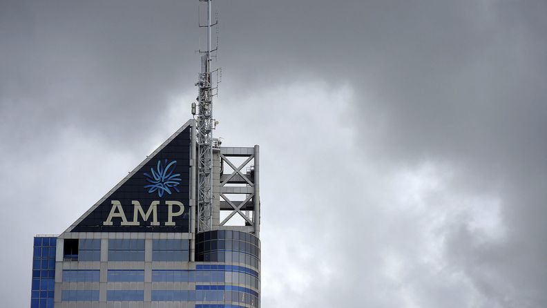 Signage for AMP Ltd. adorns the top of company's Bourke Place building in the central business district of Melbourne, Australia