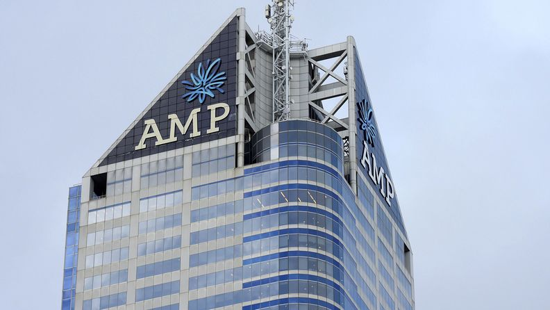 Signage for AMP Ltd. atop the company's Bourke Place building in the central business district of Melbourne on May 10, 2018