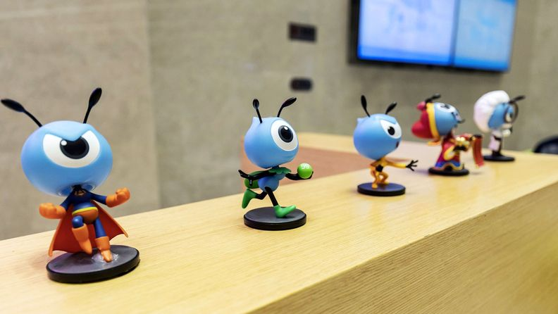 Various figurines of the mascot for Ant Financial are displayed on a reception desk in the lobby of the company's headquarters in Hangzhou, China, on Oct. 17, 2019.