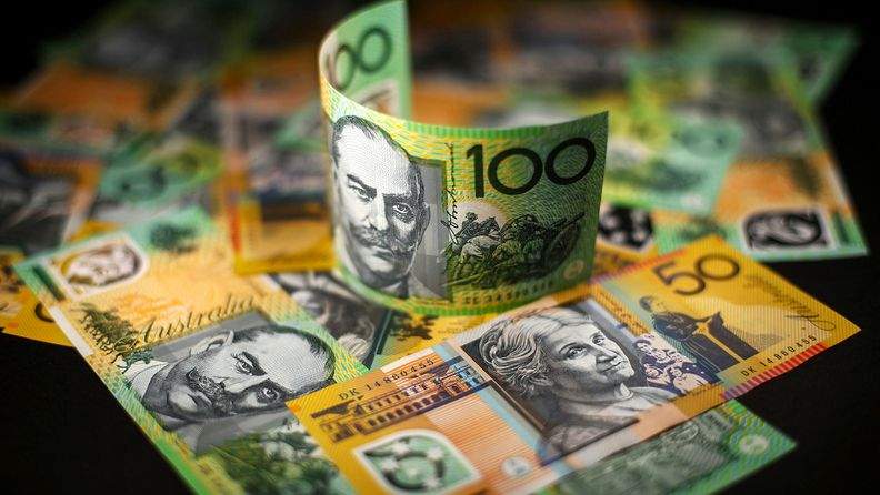 Australian A$100 and A$50 banknotes are arranged for a photograph in Sydney on May 23, 2018