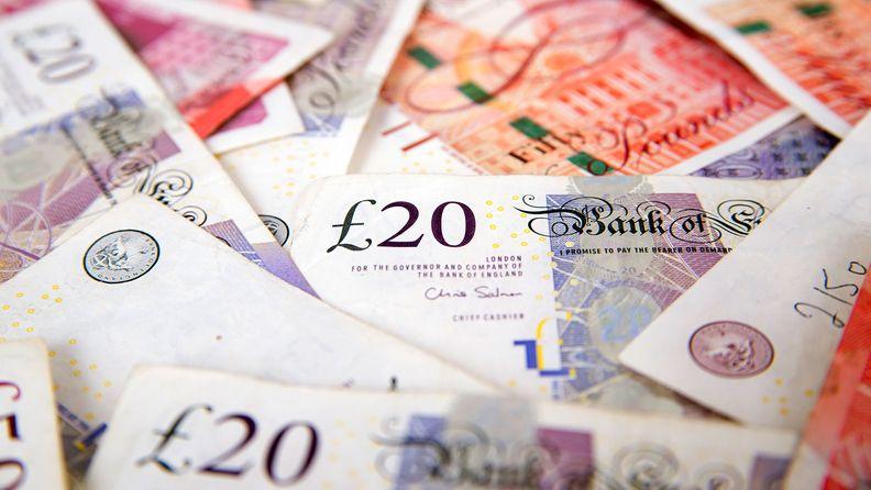 A stack of bundled British Pound Sterling banknotes