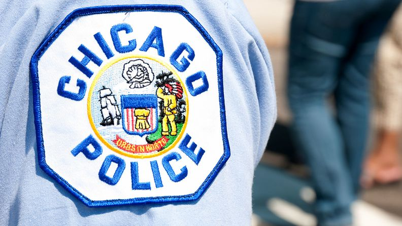 Chicago police patch on the arm of an officer at the Taste of Chicago
