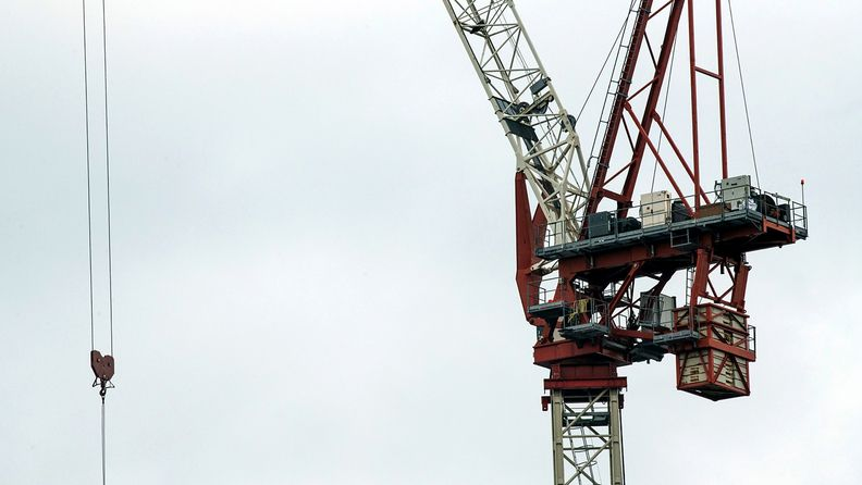 A construction crane on a commercial building site in Canada