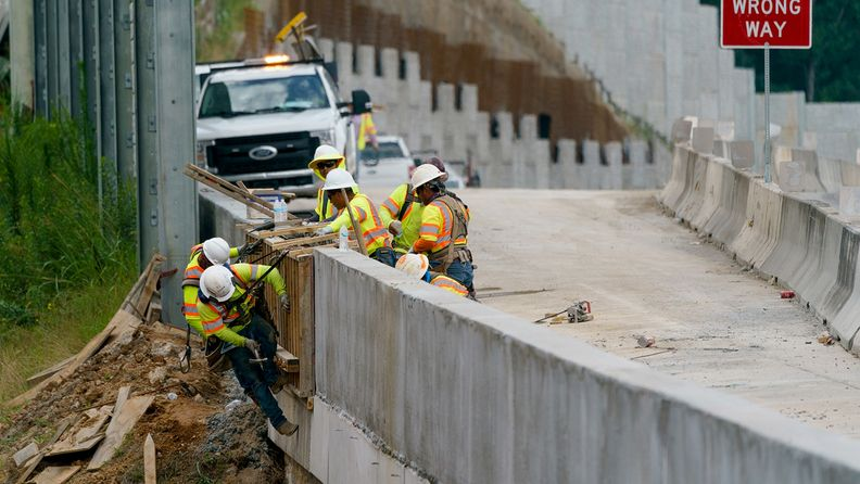 Constructions workers working on a highway entrance ramp