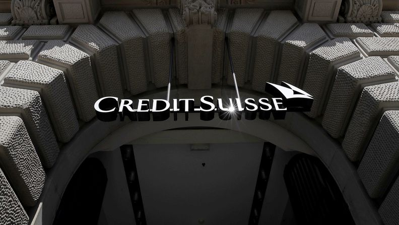 A logo hangs above the entrance to the Credit Suisse Group  headquarters in Zurich on April 17, 2020
