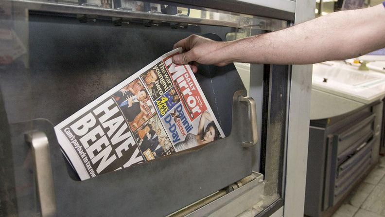 A  copy of the Daily Mirror newspaper is removed from the production line at Trinity Mirror's factory in Watford, U.K., on April 13, 2010