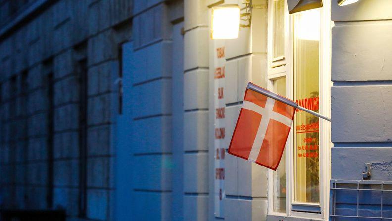 A Danish flag hangs outside a pizza restaurant in Copenhagen