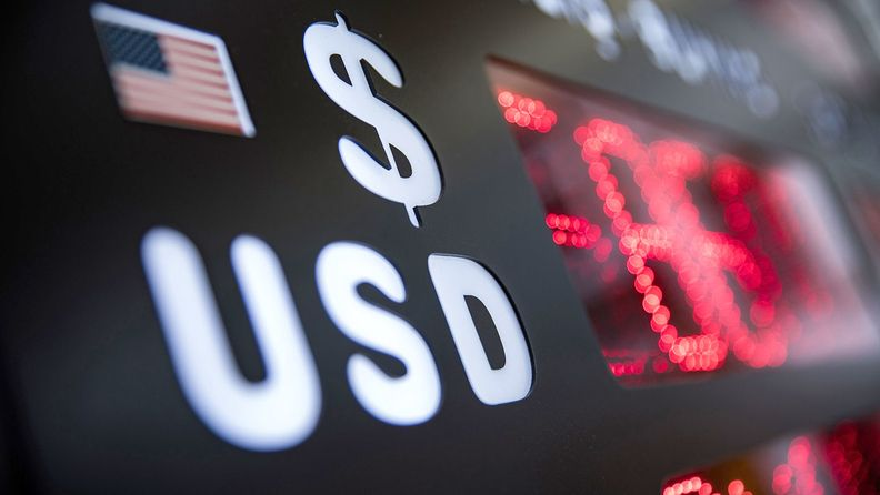 U.S. dollar trading lower shown an electronic board