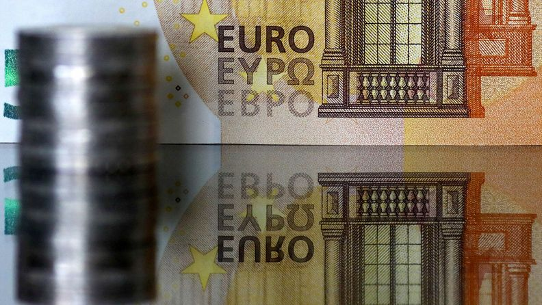 A group of euro coins and a €50 banknote