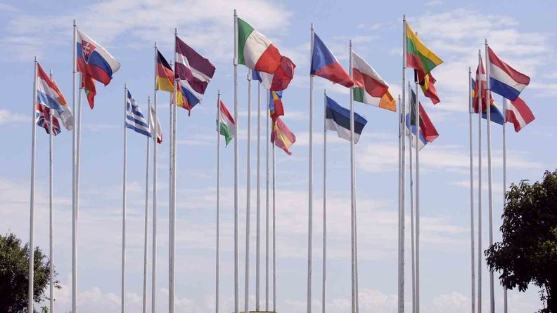 Flags of the European Union, in a circle, on tall flagpoles