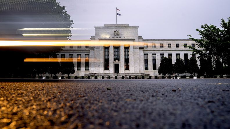 A vehicle passes by the Marriner S. Eccles Federal Reserve building in Washington