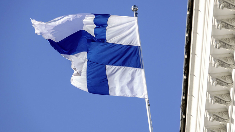 A Finnish national flag flies from the City Hall building in Helsinki