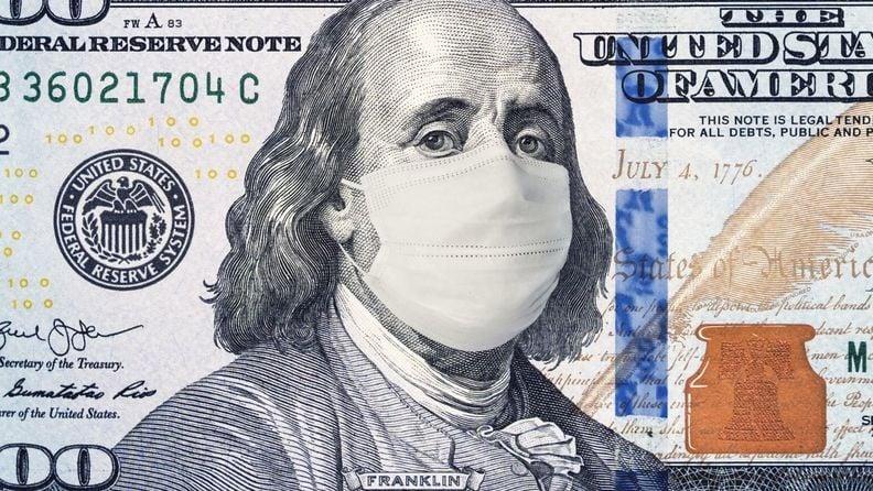 100 dollar bill with benjamin franklin wearing a medical mask