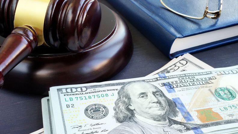 Litigation finance. Gavel and dollar banknotes.