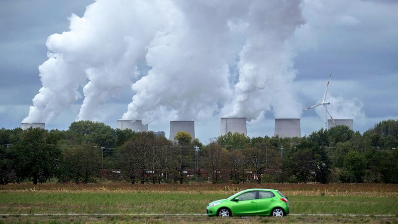 Emissions rise from cooling towers beyond a ploughed agricultural field at the Jaenschwalde lignite fired power plant in Teichland, Germany, on Sept. 16, 2019