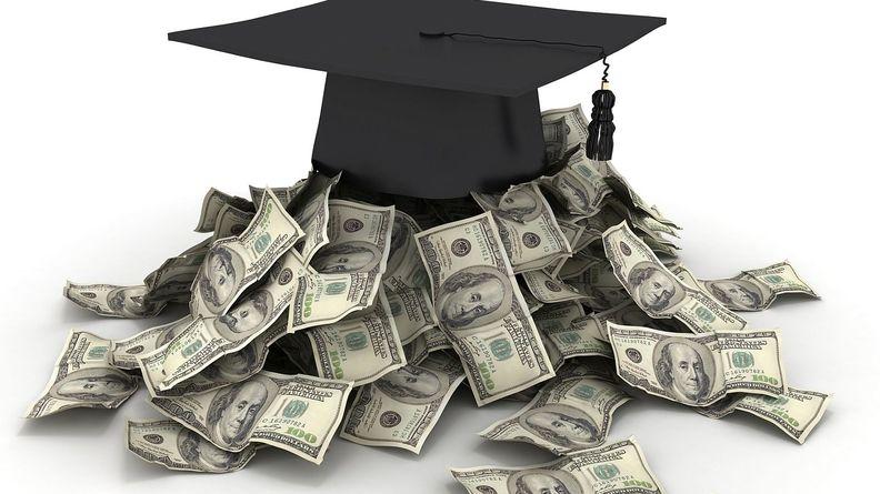 graduation cap with dollars