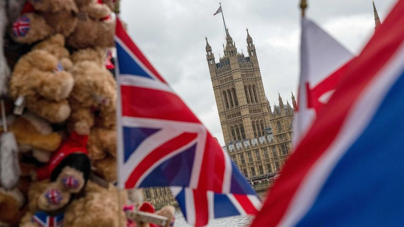 Products sit on a souvenir stall in view of the Houses of Parliament in London on Oct. 13, 2020