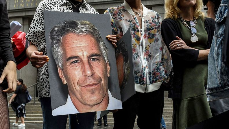A protest group holds up signs of Jeffrey Epstein in front of the Federal courthouse in New York on July 8, 2019.