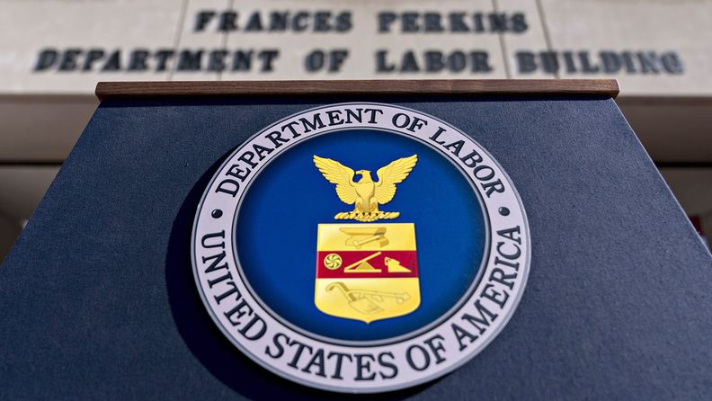 The U.S. Department of Labor seal hangs on a podium outside the headquarters in Washington