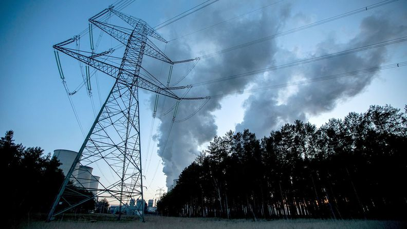 Air pollution rises from cooling towers at a lignite fired power plant in Germany
