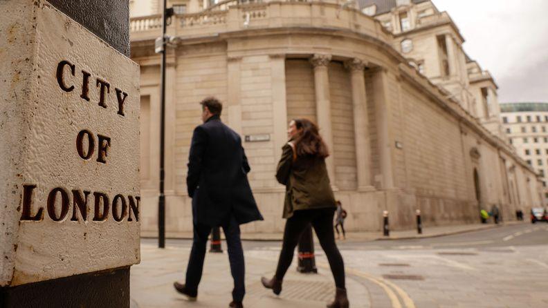 Pedestrians walk near the Bank of England in London