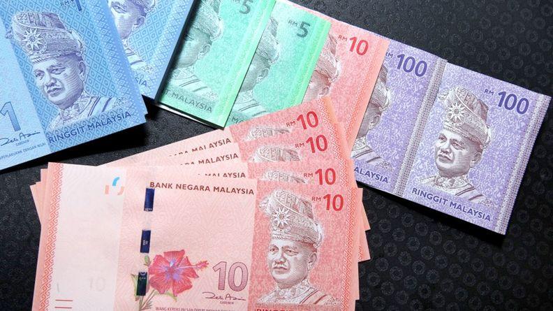Malaysian 1 ringgit and 10 ringgit banknotes photographed in Kuala Lumpur on May 3, 2013