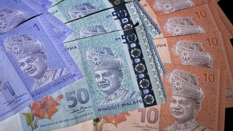 Malaysian ringgit banknotes of various denominations are arranged for a photograph in Tokyo