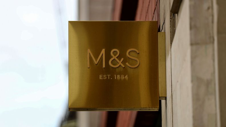 A sign hangs from a Marks & Spencer store in central London