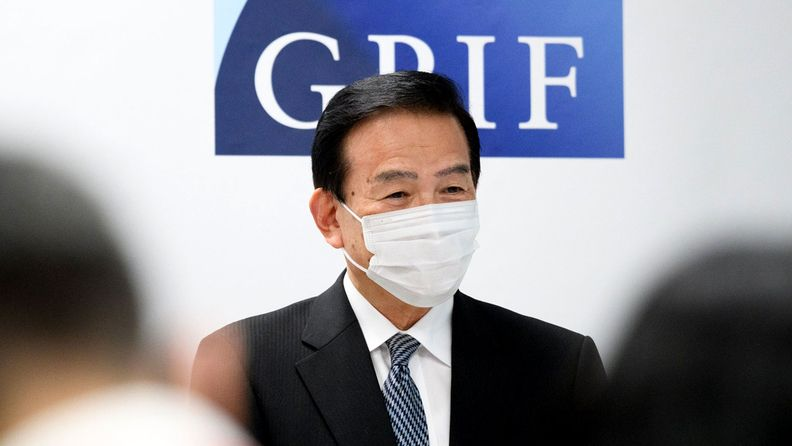 Masataka Miyazono, president of the Government Pension Investment Fund, wears a protective mask as he speaks during a news conference in Tokyo on July 3, 2020.