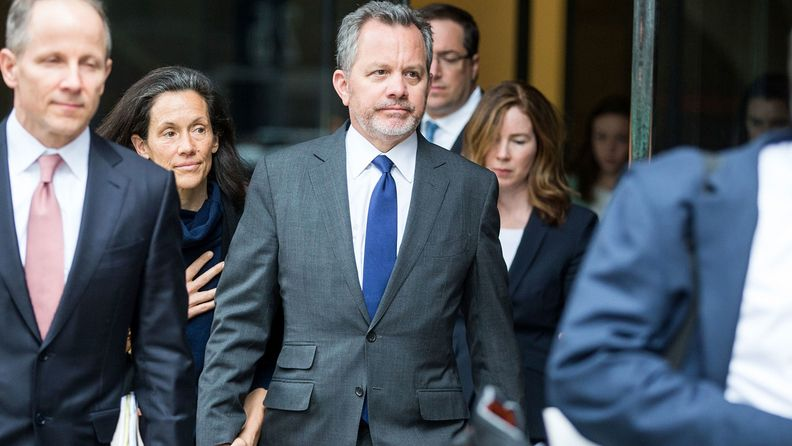 Bill McGlashan, a former top executive at TPG Growth who was fired after he was charged, center, exits federal court in Boston on March 29, 2019