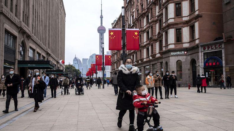 Pedestrians walk down Nanjing Road in Shanghai
