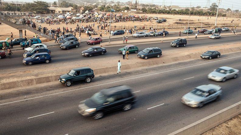 Traffic drives along the Umaru Musa Yaradua expressway in Abuja, Nigeria